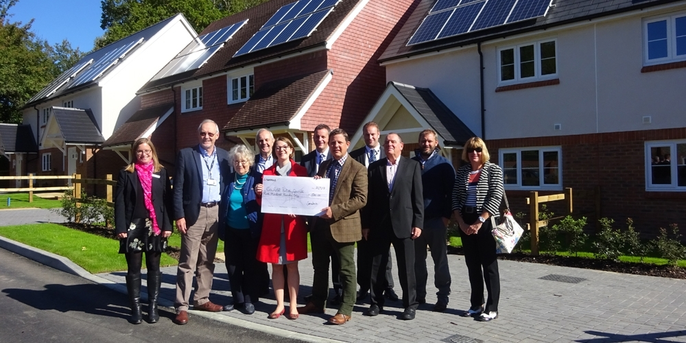 Saxon Weald marks development milestone with donation to Cowfold community